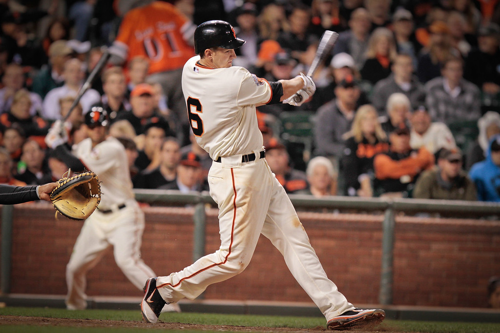 Giants 1st baseman Brett Pill hits in the Giants vs. the Diamondbacks game at AT&T Park in San Francisco, Calif., on Monday, September 26,  2011.