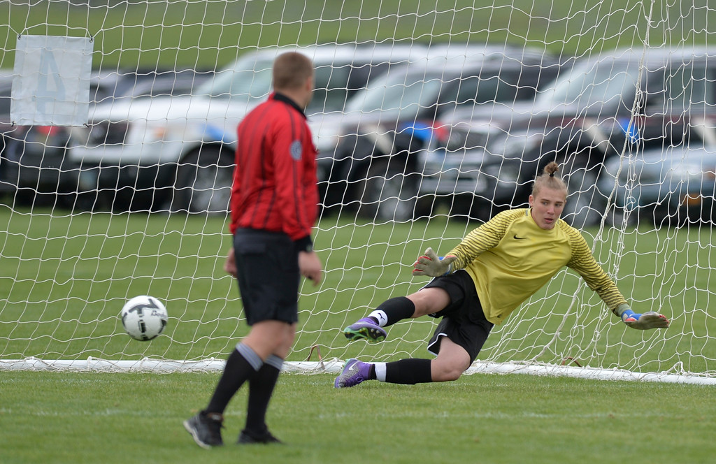 Justin Sheely | The Sheridan Press<br /> Campbell County's goalkeeper Jacoby Garcia misses the ball in the shootout during the first round of the boys class 4A State Soccer Championship Thursday at the Big Horn Equestrian Center. The Trojans won in a shootout to advance to face Cheyenne Central in the semifinals on Friday.