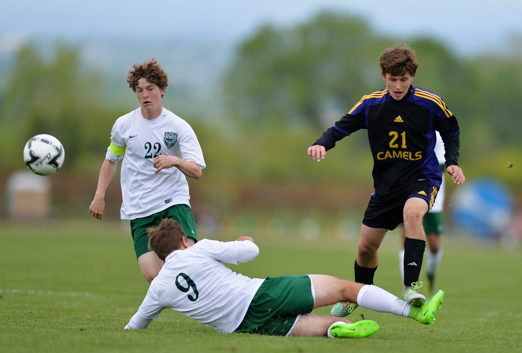 Justin Sheely | The Sheridan Press<br /> Kelly Walsh's Ryan McMullen, left, and Joey Geil defend a drive by Campbell County's Isaac Howell during the first round of the boys class 4A State Soccer Championship Thursday at the Big Horn Equestrian Center. The Trojans won in a shootout to advance to face Cheyenne Central in the semifinals on Friday.