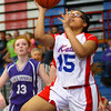 3-24-14   --- Girls 8th grade basketball City/County Championship. Kokomo's Tavin Dechard putting the ball up under the basket almost unopposed. -- <br />   KT photo | Tim Bath