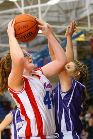 3-24-14   --- Girls 8th grade basketball City/County Championship. Kokomo's Savannah Emmons shooting with Northwestern's Morgan Mercer blocking. -- <br />   KT photo   Tim Bath