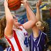 3-24-14   --- Girls 8th grade basketball City/County Championship. Kokomo's Savannah Emmons shooting with Northwestern's Morgan Mercer blocking. -- <br />   KT photo | Tim Bath