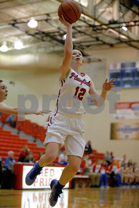 Plainfield  High School guard Samantha Olinger  (12) goes in for the lay up during the opening round of play in the Hendricks County Basketball Tournament between Cascade vs Plainfield at Plainfield  High School in Plainfield,IN. (Jeff Brown/Flyer Photo)