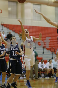 Plainfield  High School player Delaney Kendall  (3) drives past Cathedral High School junior Molly Beatty (13) and thows up her shot during the game between Cathedral vs Plainfield at  Plainfield  High School in Plainfield,IN. (Jeff Brown/Flyer Photo)