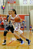 Plainfield  High School player Sarah O'Day  (23) makes a move to the basket past Cathedral High School senior Brooklin Alexander (12) during the game between Cathedral vs Plainfield at  Plainfield  High School in Plainfield,IN. (Jeff Brown/Flyer Photo)