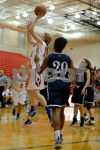 Plainfield  High School player Samantha Olinger  (12) drives down the lane and goes in for the lay up during the game between Cathedral vs Plainfield at  Plainfield  High School in Plainfield,IN. (Jeff Brown/Flyer Photo)
