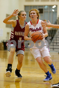 Plainfield  High School player Samantha Olinger  (12) drives down the lane past Danville  High School point guard Jenna Cowart  (5) during the game between Danville vs Plainfield at  Plainfield High School in Plainfield,IN. (Jeff Brown/Flyer Photo)