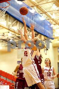 Plainfield  High School player Kaiah Haberkorn  (42) with the shot from the baseline during the game between Danville vs Plainfield at  Plainfield High School in Plainfield,IN. (Jeff Brown/Flyer Photo)