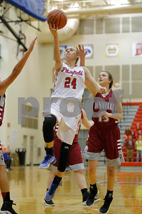 Plainfield  High School player Riley Blackwell  (24) drives down the lane past Danville  High School small guard Ella Collier  (13) and puts up the lay up during the game between Danville vs Plainfield at  Plainfield High School in Plainfield,IN. (Jeff Brown/Flyer Photo)