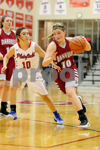 Danville  High School point guard Lexi Riggles  (10) looks to drive down the line past Plainfield  High School player Brooke Davis  (10) during the game between Danville vs Plainfield at  Plainfield High School in Plainfield,IN. (Jeff Brown/Flyer Photo)