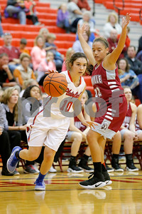Plainfield  High School player Brooke Davis  (10) drives around Danville  High School small forward Cassie Utley  (22)during the game between Danville vs Plainfield at  Plainfield High School in Plainfield,IN. (Jeff Brown/Flyer Photo)