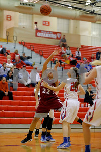 Danville  High School small forward Cassie Utley  (22) throws up the shot over Plainfield  High School player Hayley Spaulding  (25) during the game between Danville vs Plainfield at  Plainfield High School in Plainfield,IN. (Jeff Brown/Flyer Photo)