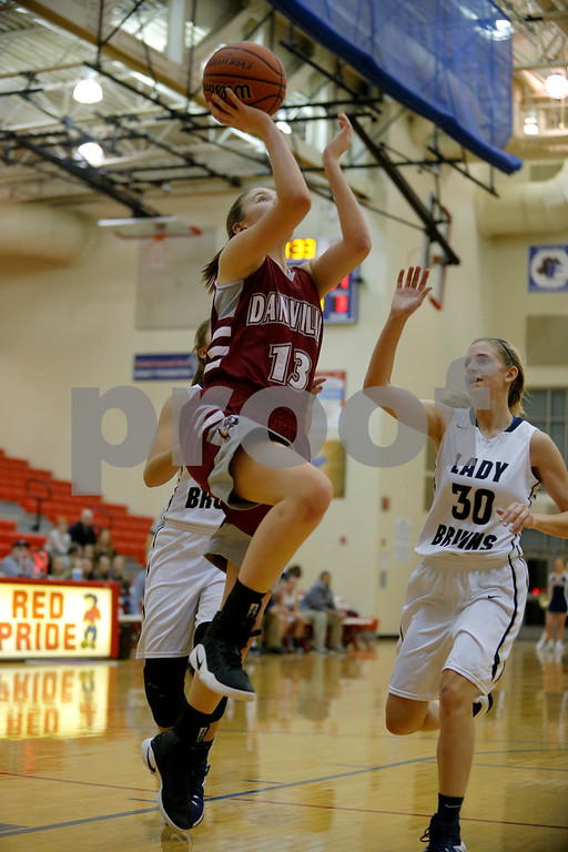 Danville  High School small guard Ella Collier  (13) with the lay up for two during the opening round of play in the Hendricks County Basketball Tournament between Cascade vs Plainfield at Plainfield  High School in Plainfield,IN. (Jeff Brown/Flyer Photo)