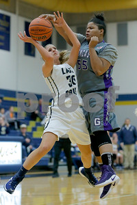 Tri-West  High School forward Carli Wilson  (30) is fouled by Greencastle High School center Nailah Ray  (55) during the game between Greencastle vs Tri-West  at  Tri-West High School in Lizton,IN. (Jeff Brown/Flyer Photo)