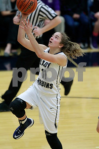 Tri-West  High School forward Lilly Johnson  (11) goes in for the lay up off the fast break during the game between Greencastle vs Tri-West  at  Tri-West High School in Lizton,IN. (Jeff Brown/Flyer Photo)