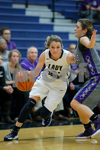 Tri-West  High School guard Maggie Cora  (21) puts her head down and drives around Greencastle High School guard Jalyn Duff  (33) during the game between Greencastle vs Tri-West  at  Tri-West High School in Lizton,IN. (Jeff Brown/Flyer Photo)