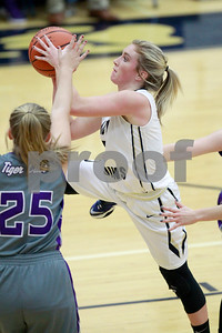 Tri-West  High School guard Skylar Jobe  (3) drives down the land and puts up her shot over Greencastle High School guard Marin Nally  (25) during the game between Greencastle vs Tri-West  at  Tri-West High School in Lizton,IN. (Jeff Brown/Flyer Photo)