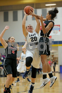 Tri-West  High School forward Hailee Gifford  (20) goes up strong to the basket and takes a hit from Sheridan High School forward  Brittany Welch  (22)during the game between Sheridan vs Tri-West  at  Tri-West Hig h School in Lizton,IN. (Jeff Brown/Flyer Photo)