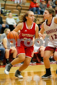 Southmont High School junior Liz Link (21) drives past Danville  High School small forward Peyton Turner  (12) along the baseline during the game between Southmont vs Danville at  Danville High School in Danville,IN. (Jeff Brown/Flyer Photo)