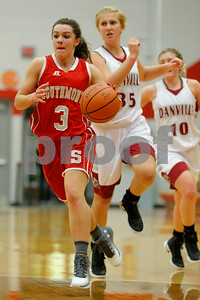 Southmont High School senior Kasey Burton (3) drives past Danville  High School power forward Olivia Hayse  (35) on her way to scoring during the game between Southmont vs Danville at  Danville High School in Danville,IN. (Jeff Brown/Flyer Photo)