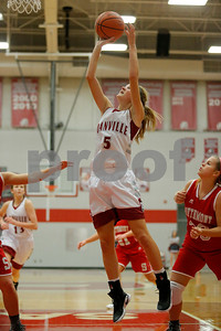 Danville  High School point guard Jenna Cowart  (5) drives past Southmont High School sophomore Claire Remley (33) and takes it in for two during the game between Southmont vs Danville at  Danville High School in Danville,IN. (Jeff Brown/Flyer Photo)