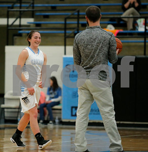 Cascade  High School guard Makayla Collier(C)  (0) walks out to center court  to accept the basketball from Cascade  High School Head Coach David Carpenter  (HC)during the game between Speedway vs  Cascade  at  Cascade High School in Clayton,IN. (Jeff Brown/Flyer Photo)