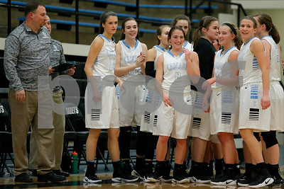 Cascade  High School player Makayla Collier (0) is surrounded by her teammates after scoring her 1,000th career point during the game between Speedway vs  Cascade  at  Cascade High School in Clayton,IN. (Jeff Brown/Flyer Photo)
