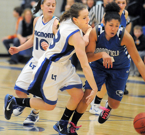 Tyana Medema, Broomfield collides with Jamie Katuna, Longmont during Tuesday's game at Longmont High.<br /> <br /> February 8, 2011<br /> staff photo/David R. Jennings
