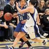 Tyana Medema, Broomfield takes the ball down court against Erica Meier,  Longmont during Tuesday's game at Longmont High.<br /> <br /> February 8, 2011<br /> staff photo/David R. Jennings
