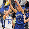 Katie Nehf, Broomfield passes the ball over Erica Meier, Longmont during Tuesday's game at Longmont High.<br /> <br /> February 8, 2011<br /> staff photo/David R. Jennings