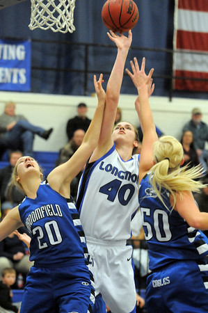 Megan Carpenter, Longmont shoots past Meagan Prins, left, and Bre Burgesser, Broomfield during Tuesday's game at Longmont High.<br /> <br /> February 8, 2011<br /> staff photo/David R. Jennings