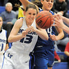 Jamie Katuna, Longmont passes the ball to another player past Broomfield's Katie Nehf during Tuesday's game at Longmont High.<br /> <br /> February 8, 2011<br /> staff photo/David R. Jennings