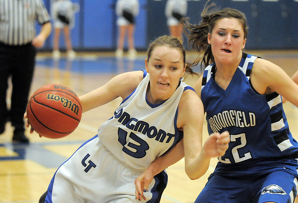 Longmont's Jamie Katuna drives the ball around Broomfield's Britteny Zec during Tuesday's game at Longmont High.<br /> <br /> February 8, 2011<br /> staff photo/David R. Jennings