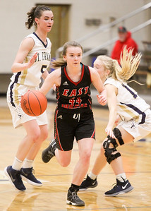 Record-Eagle/Brett A. Sommers East Jordan's Lilly Black dribbles the ball up the floor during Tuesday's girls basketball game against Traverse City St. Francis. St. Francis won 39-37 in overtime.