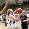 Record-Eagle/Brett A. Sommers Traverse City St. Francis' Maddy Wierda attempts a shot during Tuesday's girls basketball game against East Jordan. St. Francis won 39-37 in overtime.