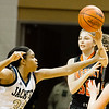 Record-Eagle/Brett A. Sommers Kingsley's Jacie King passes over Detroit Country Day's Destini Lewis during Friday's Class B semifinal at Calvin College's Van Noord Arena. Country Day won 70-54.