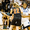 Record-Eagle/Brett A. Sommers Detroit Country Day's Maxine Moore sets a screen against KIngsley's Kelsie Bies during Friday's Class B semifinal at Calvin College's Van Noord Arena. Country Day won 70-54.