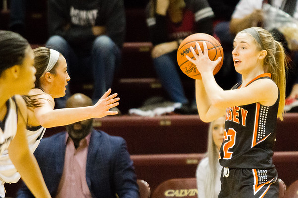Record-Eagle/Brett A. Sommers Kingsley's Kelsie Bies looks to pass around Detroit Country Day's Maddie Novak during Friday's Class B semifinal at Calvin College's Van Noord Arena. Country Day won 70-54.