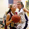 Record-Eagle/Jan-Michael Stump<br /> Leland's Tantzi Snyder (14) defends McBain NMC's Allison Mentel (23) in the first half of Thursday's game.