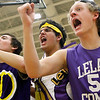 Record-Eagle/Jan-Michael Stump<br /> From left, Leland fans Matt Fleis, Jared Ornelas (cq) and Peter Fellows (cq) cheer during Thursday's win over McBain NMC.