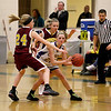 Record-Eagle/Jan-Michael Stump<br /> McBain NMC's Adriana Sigafoose (24) and Allison Mentel (23) try to trap Leland's Isabelle Scott (20) in the third quarter of Thursday's game.