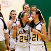 Record-Eagle/Jan-Michael Stump<br /> Leland's Hanna Schaub (24) and Margaret Osorio (21) celebrate Thursday's 50-30 win over McBain NMC.