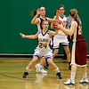 Record-Eagle/Jan-Michael Stump<br /> Leland's Hanna Schaub (24) defends McBain NMC Emma Towers (22) in the second quarter of Thursday's game.