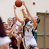 Record-Eagle/Jan-Michael Stump<br /> Leland's Hanna Schaub (24) reaches for rebound with McBain NMC's Allison Mentel (23)in the second quarter of Thursday's game.
