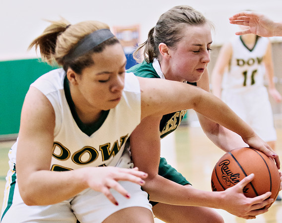 Record-Eagle/Pete Rodman<br /> Midland Dow's Asija Bobalek-Blanton, left, and Traverse City West's Katie Placek battle for a rebound during a high school girls basketball game in the Traverse City Christmas Classic at Traverse City West High School on Tuesday.