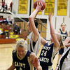 Record-Eagle/Keith King<br /> Traverse City Central's Molly Walker grabs a rebound against Traverse City St. Francis Tuesday, February 14, 2012 at Traverse City Central High School.