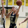 Record-Eagle/Keith King<br /> Traverse City St. Francis' Liza Erickson (32) puts up a shot near Traverse City Central's Ali Walker, left, and Logan Core, right, Tuesday, February 14, 2012 at Traverse City Central High School.