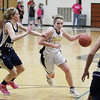 Record-Eagle/Keith King<br /> Traverse City Central's Madi Bankey takes the ball in against Traverse City St. Francis' Kaitlin Feeney Tuesday, February 14, 2012 at Traverse City Central High School.