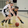 Record-Eagle/Keith King<br /> Traverse City Central's Brianna Podsaid, left, and Traverse City St. Francis' McKaely Ludka go for the ball Tuesday, February 14, 2012 at Traverse City Central High School.