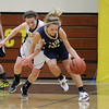 Record-Eagle/Keith King<br /> Traverse City St. Francis' Lauren Buckel fights to keep the ball from Traverse City Central's Katie Knudsen Tuesday, February 14, 2012 at Traverse City Central High School.